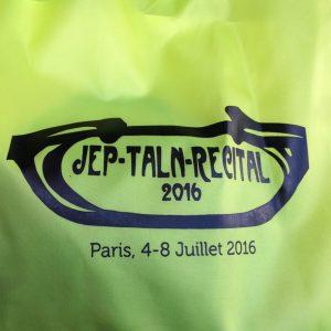 Logo de la conférence JEP-TALN-RÉCITAL - détail du sac offert parmi les autres cadeaux